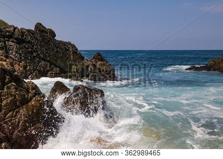 Waves Crash On The Rocks In Playa Mayto In Jalisco, Mexico.