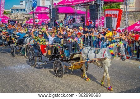Cartagena, Colombia - November 07, 2019: Unidentified Group Of People On The Back Of A Horse Drawn C