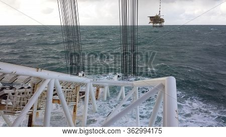 A Pipe-laying Vessel With A Stinger Lifts A Pipe From The Seabed