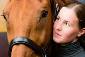 Woman and horse together woman looks toward horse poster