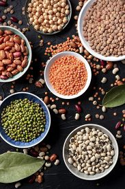 Legumes Variety, Overhead Shot On A Black Background. Lentils, Soybeans, Chickpeas, Red Kidney Beans
