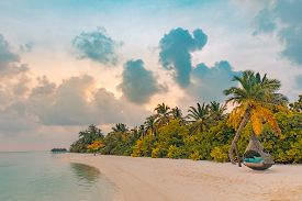 Landscape Of Paradise Tropical Island Beach, Sunrise Sunset Background. Tropical Beach Sunset As Sum