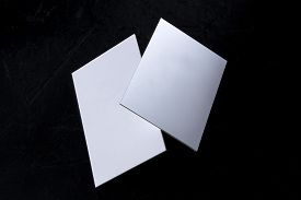 White 3 Ply Business Cards, Floating On A Black Background, A Mock-up