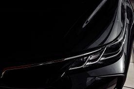 Headlight Of Modern Prestigious Black Car Close Up. Close Up Photo Of Modern Car, Detail Of Headligh