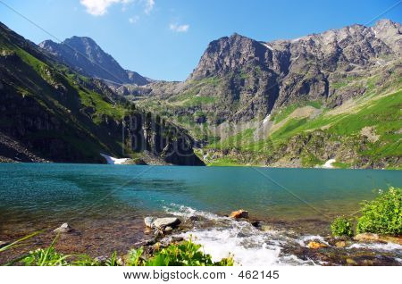 Turquoise Lake In The Mountains. Altay