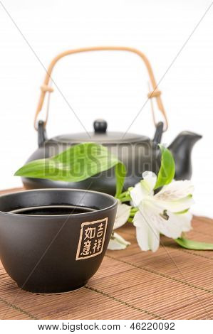 Asian teapot and cup