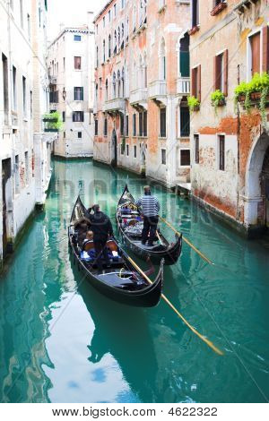 Gondoliers On Water