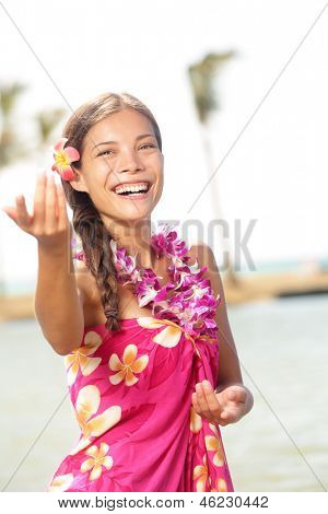 Hula dancer woman dancing hula dance on Hawaii wearing Hawaiian orchid flower lei smiling happy on beach. Travel vacation summer holidays image of beautiful mixed race girl in colorful pink sarong. poster