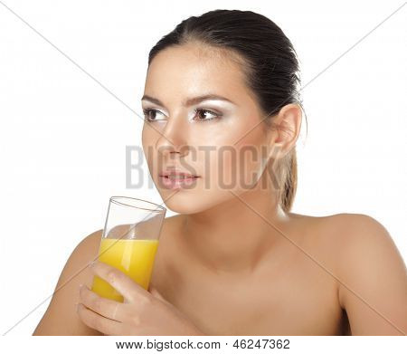 A young woman drinking orange juice , isolated on white background