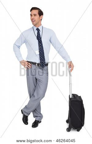 Smiling businessman waiting with his luggage on white background