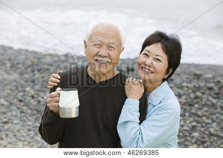 Portrait of a happy and loving mature couple at the beach