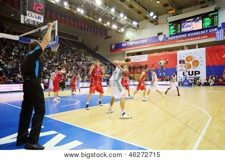 MOSCOW - SEP 29: Zalgiris (Lithuania, in white) and CSKA Moscow (Russia, in red) teams play basketball in tournament for cup named Gomelsky in CSKA sports center, on Sep 29, 2012 in Moscow, Russia.