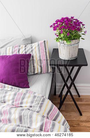 Purple Flowers In A Bright Bedroom