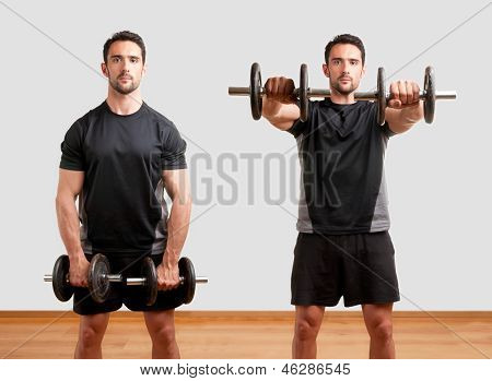 Personal Trainer doing front dumbell raises for training his deltoids in a gym poster