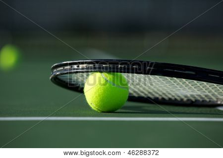 Tennis Ball and Racket on the Court with room for copy