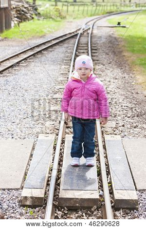 little girl at Ravenglass and Eskdale narrow gauge railway, Cumbria, England