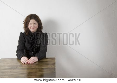Smiling Attractive Young Woman In Black Shirt