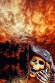 Pirate skeleton in the caribbeans at dusk poster