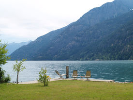 Lounge Chairs At A Mountain Lake On A Cloudy Day - Lake Chelan Wa Usa