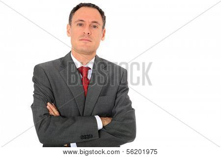 Serious looking businessman. All on white background