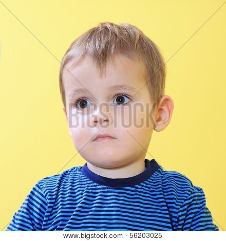 Sad little toddler missing his mum in kindergarten.