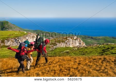 Hikers Climbing The Mountain