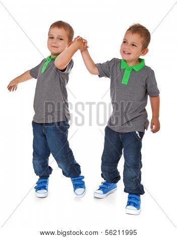 Full length shot of twin brothers. All on white background.