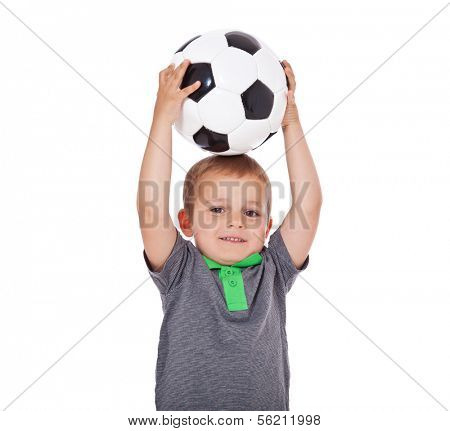 Cute little boy holding soccer ball. All on white background.