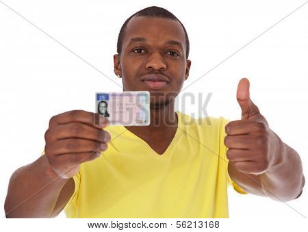 Attractive black guy proudly showing his driver license. All on white background.