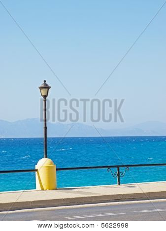 View on Aegean Sea from Rhodes embankment with turkish coast and clear sky in background poster