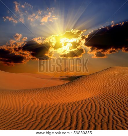 dramatic cloudy suset landscape in desert