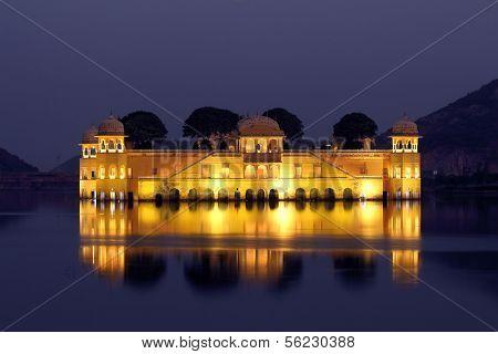 jal mahal palace on lake at night in Jaipur India