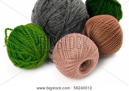 Few Balls Of Wool On A White Background