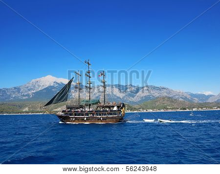 Kemer, Turkey - 14.06.2013: Ship With Tourists Swimming In The Sea On A Background Of ..mountains Ta