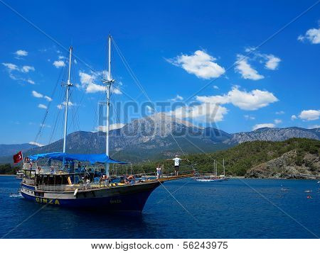 Ship With Tourists Swimming In The Sea On A Background Of Mountains Tahtal?