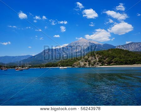 Tourist Boats Are In The Bay Against Mountain Tahtal?