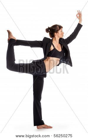 Woman In Yoga Pose Wearing A Business Suit.