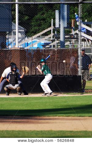 Little league player at bat.