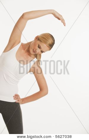 Young Woman Stretching In Workout Clothes