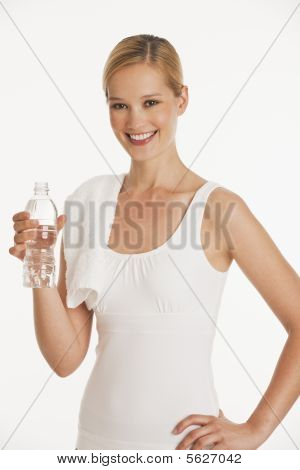Young Woman In Workout Clothes With Bottle Of Water