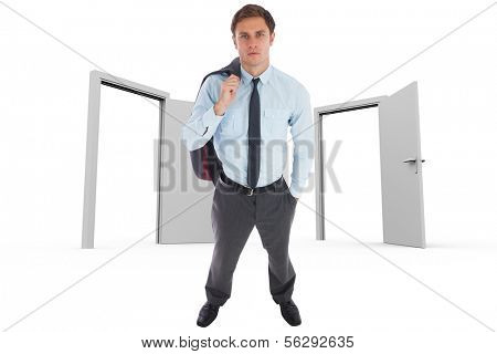Serious businessman holding his jacket against open doors