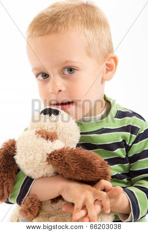 Little Boy With His Plush Puppy. Isolated On White.