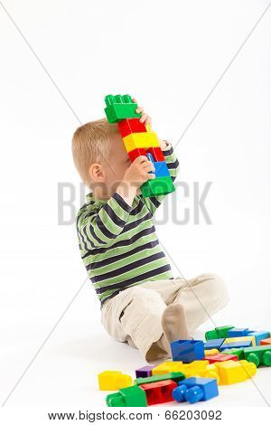 Little Cute Boy Playing With Building Blocks. Isolated On White.