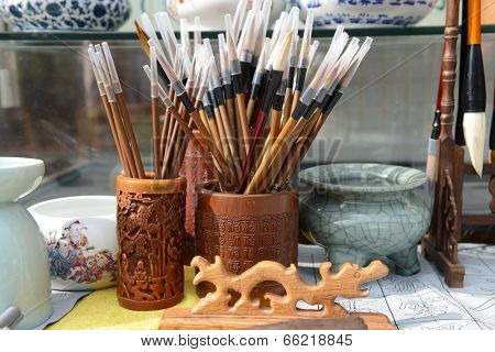 Chinese writing brushes and inkstone on the table,the word mean make of brush