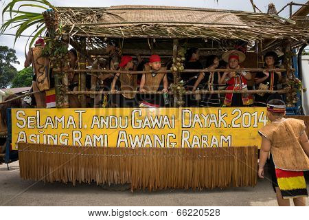 SARAWAK, MALAYSIA: JUNE 1, 2014: People of the Bidayuh tribe, an indigenous native people of Borneo, take part in a street parade on board a lorry to celebrate the Gawai Dayak festival.