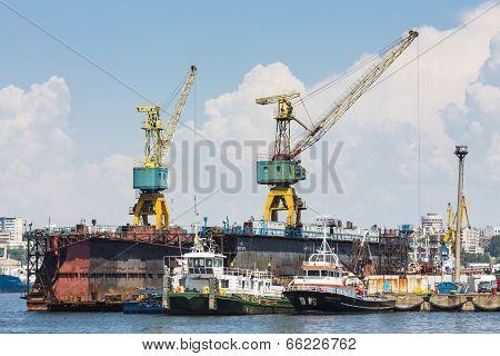 Towboats And Cranes In Shipyard