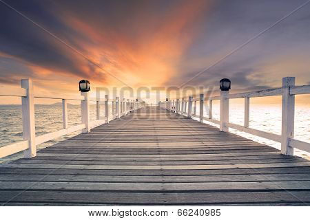 old wood bridg pier with nobody against beautiful dusky sky use for natural background backdrop and multipurpose sea scene poster