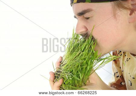 Young Man Nipping Green Grass