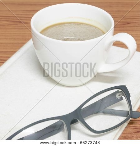 Coffee Cup And Notebook With Glasses