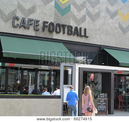 LONDON- JUNE 7: Famous english footballers, ryan giggs and gary neville have opened a new 140-seat restaurant called Cafe Football in westfield, stratford city, LONDON, JUNE 7, 2014.